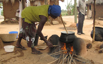 Woman cooking over an open fire