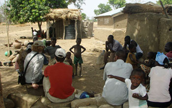 Villagers and researchers talk about the benefits of more efficient cookstoves.