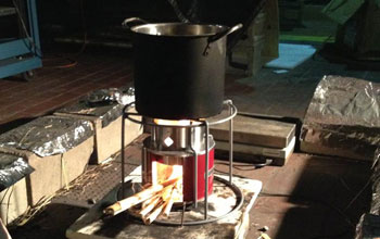 The new EZY stove using millet stalks as fuel is tested for emissions in a lab.