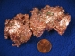 This image shows copper in ore and a penny.