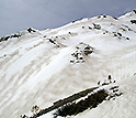 Photo of zebra stripes of dust and snow, visible on the snow surface in Colorado's mountains.