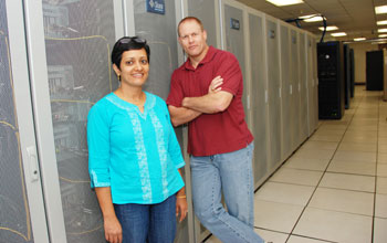 Photo of Jay Aikat and Michael Reiter in a machine room.