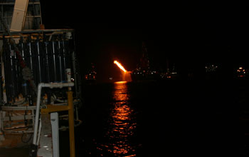 Image showing night-time recovery of a sampling device at the the Deepwater Horizon oil spill.