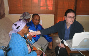Photo of linguist Johanna Brugman of Cornell, right, with Ouma Katrina Esau and Willem Damarah.
