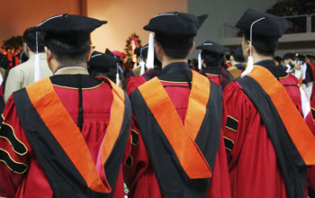 Photo of students with PhD caps and gowns