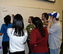 Photo of college chemistry and design students collaborating on scientific concepts.