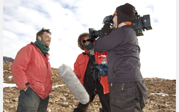 Photo of earth scientist David Marchant being interviewed in the McMurdo Dry Valleys.