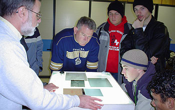 Small group gathered around photographic plates.