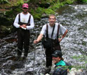 Photo of three researchers in a river.