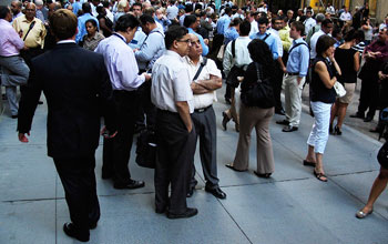 Photo of a crowd of people outside New York's Wall Street.