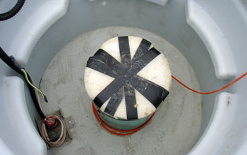 Image showing the seismometer wrapped in insulating material at the bottom of the vault.