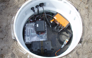 Image showing electronic components and communications system in the upper section of vault.