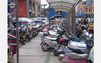 Photo shows a parking lot in China filled with e-bikes.