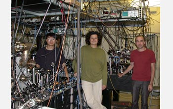 Photo of James Chou, Daniel Felantro and Hugues de Riedmatten in their entanglement lab at Caltech.