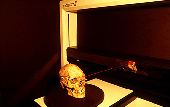 Photo of human cranium being scanned in the High Resolution X-ray Computed Tomography Facility
