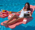 Image of a woman in a bathing suit floating in a pool viewing a electrofluidic display technology.