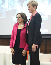 NSF Director France Córdova and Heidi Capozzi, Boeing senior vice president of human resources, stand together on a stage.