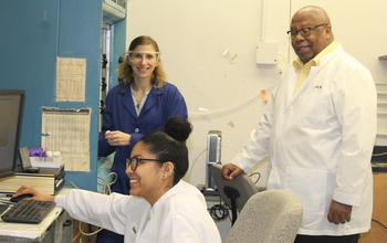 Warner and students in lab.
