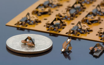 Photo of tiny, engineered origami structures.