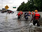 First responders performing rescues during floods from Hurricane Harvey's rains