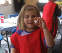 Photo of a student showing off her home-made bouncy ball at The Discovery Museums, Acton, Mass.