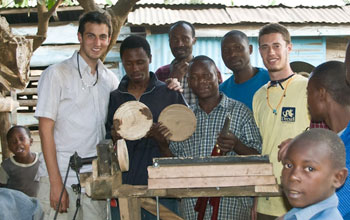 Graduate Research Fellow is shown with community members in Tanzania