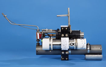 Image of an isobaric gas-tight sampler which sips fluids jetting into the sea through a snorkel.