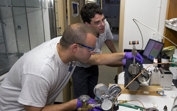Image of Sean Sylva (left) and Jeff Seewald extracting a sample.