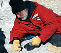 William Hammer works on a find near the Beardmore Glacier.