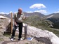 citizen scientist with rain gauge in Rocky Mountains