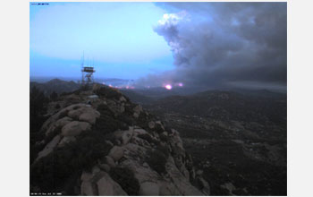 Photo of an image of a fire captured by an HPWREN automated digital camera on Lyons Peak.