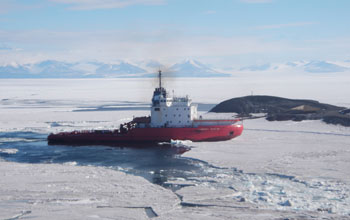 Photo of the Russian icebreaker Vladimir Ignatyuk breaking a path in sea ice in Antarctica.
