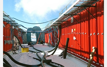 Equipment and buildings support the IceCube drilling project at the South Pole.