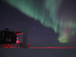 The aurora australis shines above NSF's IceCube Neutrino Observatory at NSF's Amundsen-Scott South Pole Station.