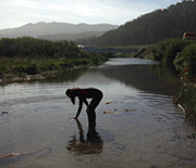 a student stands in a river