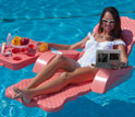 Photo of a woman in a lounge chair in a swimming pool watching an electrofluidic display.