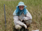 Photo of Virginia Schutte collecting data in the field.