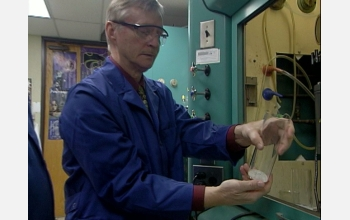FAST-ACT developer Ken Klabunde holds a canister of the powder he developed.