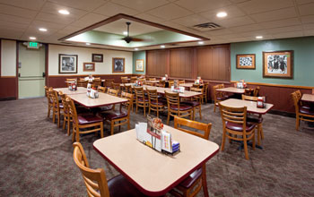 Image of a dining room of a Denny's restaurant illuminated with Cree LR6 LED downlights.