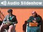 Two people in chairs and the words Audio Slideshow