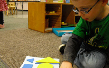 Photo of a preschooler matching shapes in the Building Blocks Shape Set.