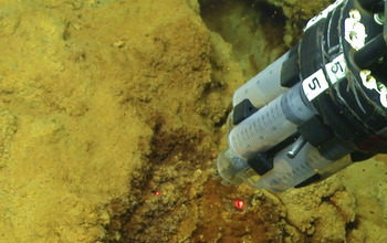instrument collecting microbial mat samples from the seamount's iron-oxidizing bacteria