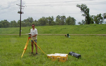 Image of Torbj�rn T�rnqvist determining the elevation of a GPS-antenna in the Mississippi Delta.