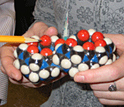 Photo of a 3-D model of a molecular container created by Lyle Isaacs.