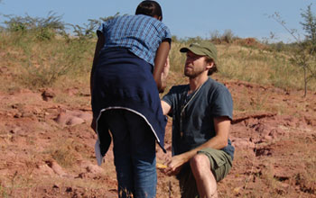 researchers looking at samples in the field
