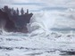 Oceans send plumes of sea spray into the atmosphere as waves hit a rocky coast