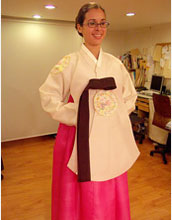 Photo of Margie Serrato wearing her gift of a Hanbok, the traditional Korean dress.