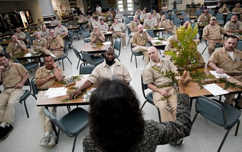 Nadkarni explains tree biology to medium security inmates at the Stafford Creek Corrections Center.
