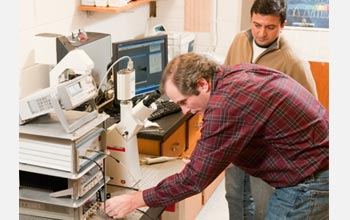 Photo of researchers Bret Flanders and Prem Thapa in their laboratory at Kansas State University.