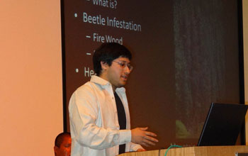 Photo of Raphael Perea delivering a presentation.